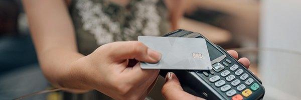 female handing over gird card as payment